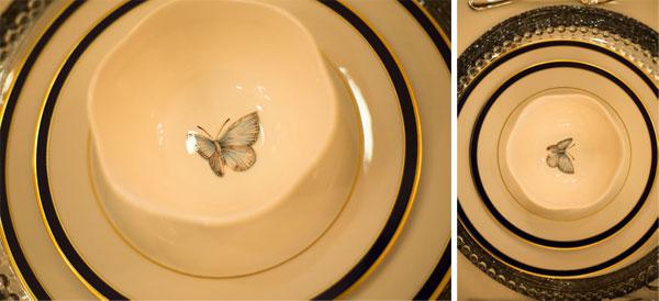 Mesa posta com porcelana de borboletas